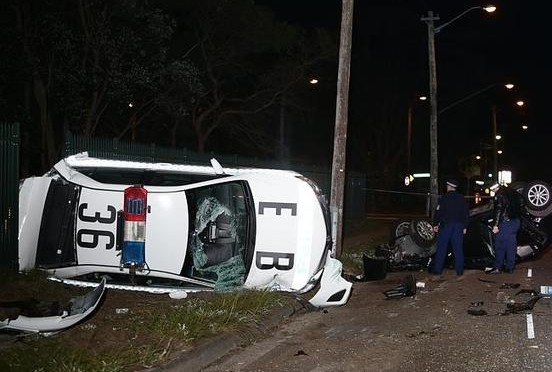 Three Officers Injured In Overturned Cruiser After Being Hit By Stolen Car