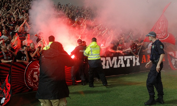 Wanderers fans taunt police and security during a match at Parramatta stadium in February. Photograph: Quentin Jones/AAP