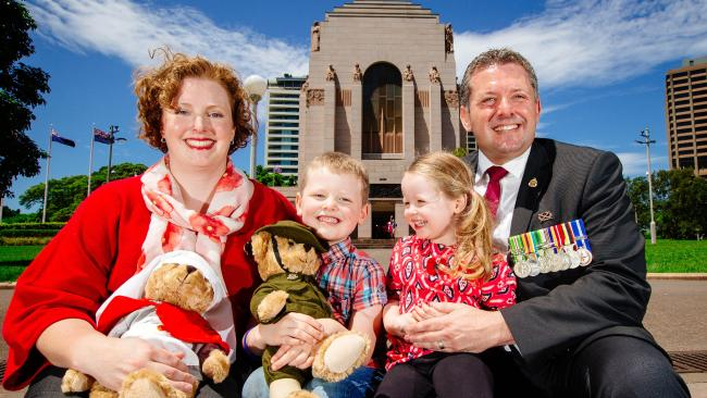 RSL state secretary and Afghanistan veteran Glenn Kolomeitz with wife Dr Emma Gilchrist and their children Nicholas, 5, and Lara, 3 at the Hyde Park war memorial, Sydney. Picture: Jonathan Ng
