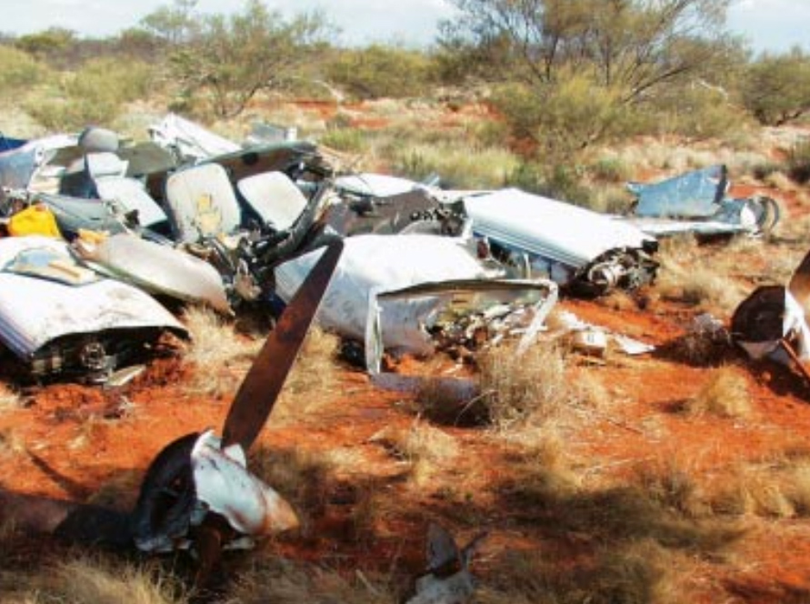View of wreckage from front of aircraft (roof of aircraft cabin cut away by emergency services personnel, prior to arrival of ATSB investigators)