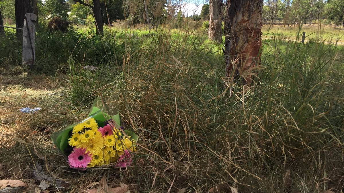 Tribute: Flowers at the scene of the accident. Picture: Perry Duffin
